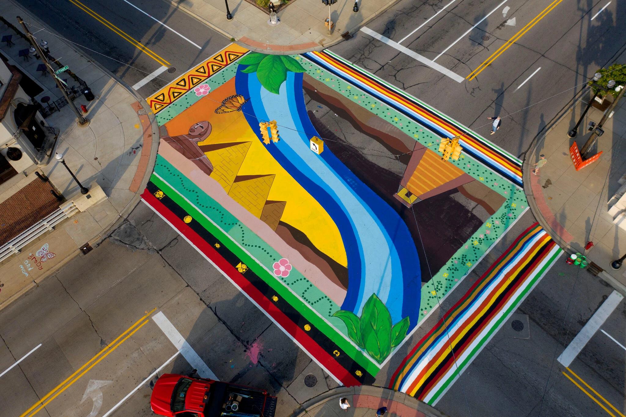 Retrieved from https://www.nytimes.com/2021/05/20/arts/murals-asphalt-streets.html
